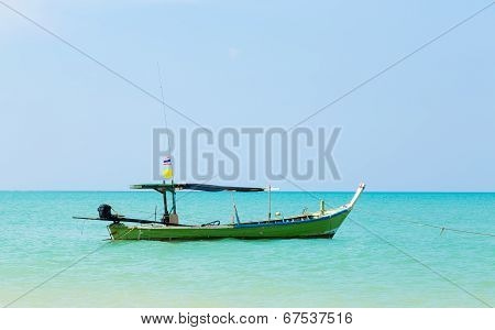 White Sand Beach And Boat