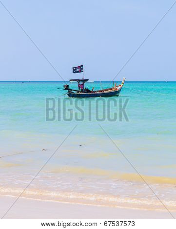 White Sand Beach And Pirate Boat