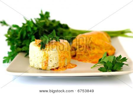 Rice with paprika chicken sauce and parsley