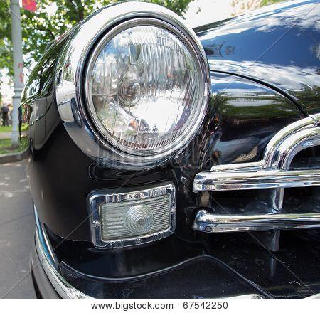 GAZ-12 ZIM car headlight on show of collection Retrofest cars