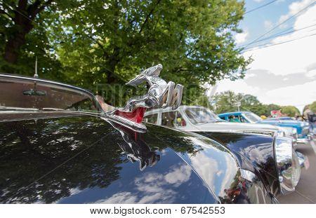 Car emblem Volga GAZ-21 on show of collection Retrofest cars