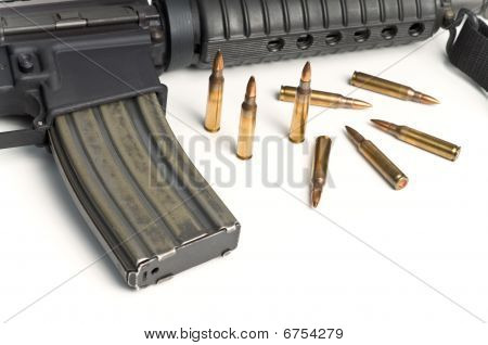 223 Bullets With Military Assault Rifle On White