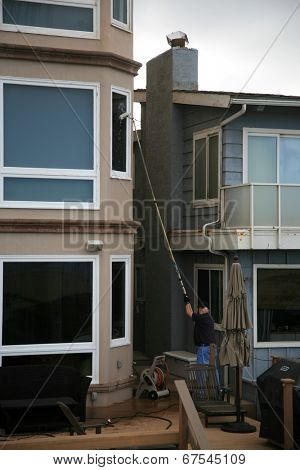 Window Washing with Deionized water and extension pole. For a Spot Free Wash and Rinse!