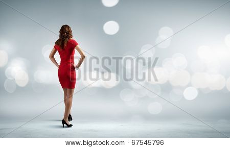 Rear view of woman in red dress against bokeh background