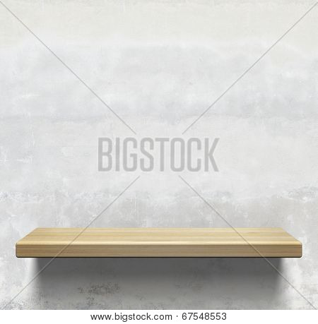 Wooden shelf on concrete wall