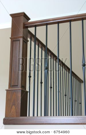 Bannister with wrought iron and stained oak