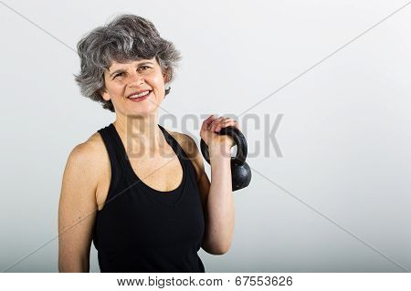 Middle Aged Female Sports Trainer With Kettle Bell