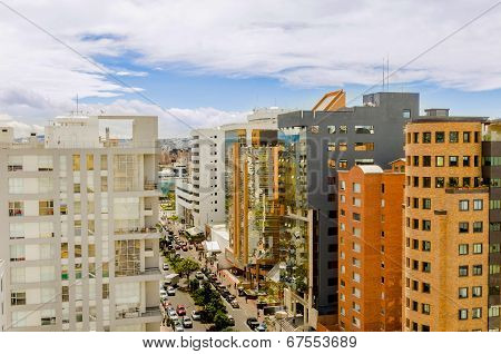 daytime city street with tall buildings