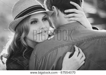 cute young girl hugging a loved looking over her shoulder at the camera