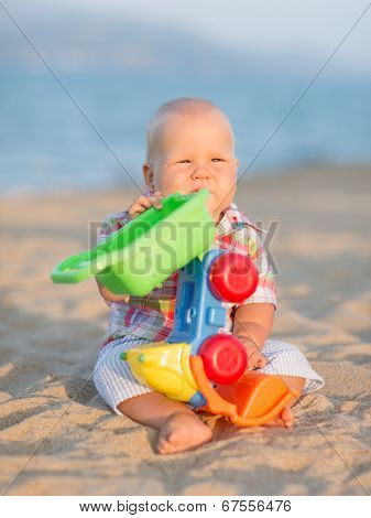 Cute baby is playing toy car