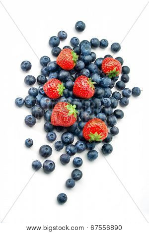 Fresh blueberries and strawberries on white background