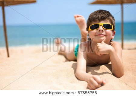 Close-up portrait of little boy on the beach