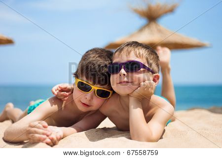 Close-up portrait of little boys on the beach