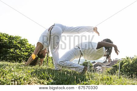 Capoeira couple of awesome stunt outdoors