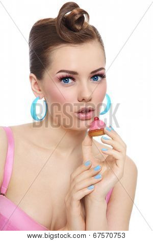 Portrait of young beautiful sexy woman with petit four pastry in her hand over white background