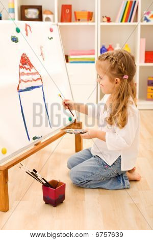 Little Girl Painting A House
