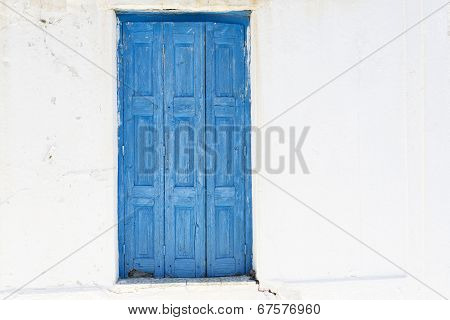 Closed painted door, seen in Greece