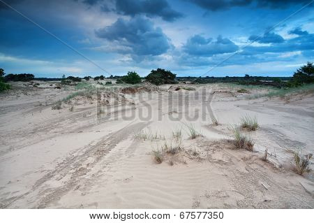 Clouded Sky Over Sand Dunes