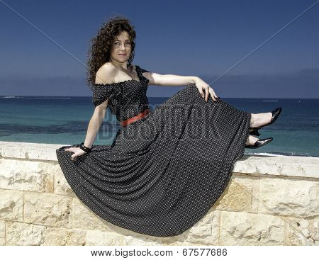 Girl In A Beautiful Dress Against The Sea