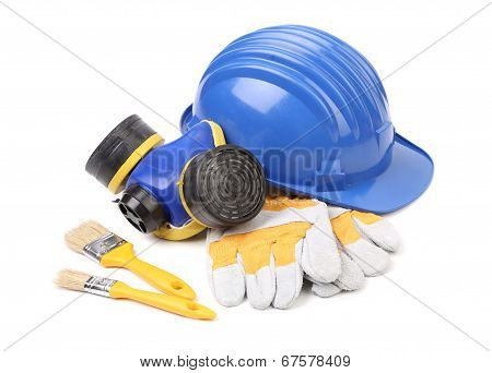 Safety helmet gloves and respirator.