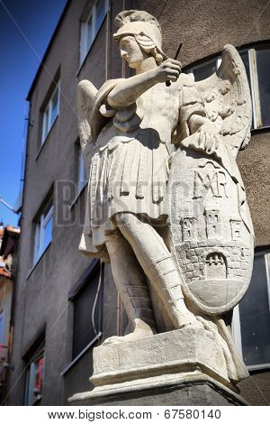 Ancient statue of archangel Michael with emblem of Bratislava city on the shield, Slovakia