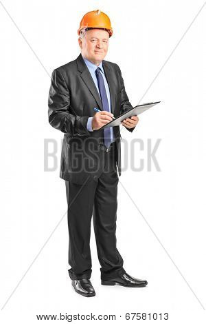 Full length portrait of a mature construction supervisor holding a clipboard isolated on white background