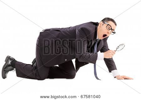Man searching for something with a magnifier isolated on white background