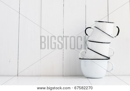 Five White Enameled Mugs