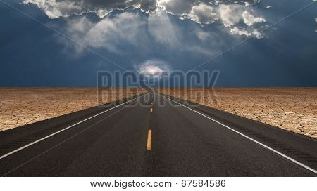 Road leads into desert toward galaxy above horizon Elements of this image furnished by NASA