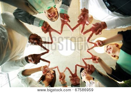 business and succcess concept - happy group of businesspeople showing v-sign together