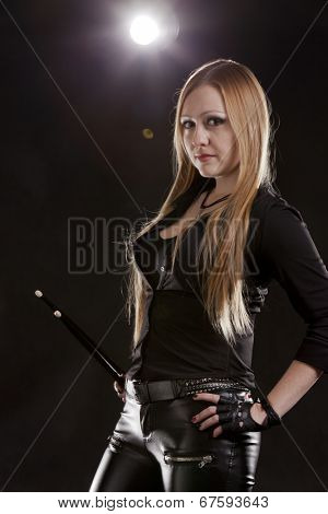 Young Woman Holding Drumstick; Indoors