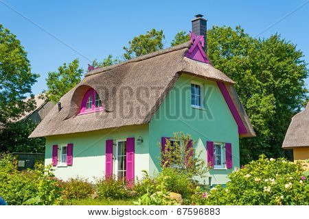 Mint Green Thatched-roof Vacation House