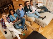 picture of exams  - Group of multi ethnic young students preparing for exams in home interior  - JPG