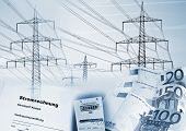 stock photo of electricity pylon  - Electricity pylons electricity meter money and a document with the german word  - JPG