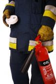stock photo of beep  - Firefighter holding an extinguisher and a smoke detector - JPG