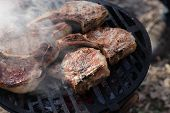 picture of flank steak  - Smoked pork on a barbecue grill at picnic - JPG