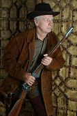 foto of bandit  - Mature male Bandit with gun in the wild west - JPG