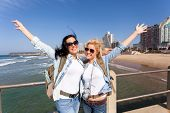 image of beachfront  - two cheerful tourists by beachfront of Durban - JPG