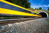 foto of passenger train  - Fast train passing through a tunnel on a lovely summer day  - JPG
