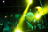 stock photo of drum-kit  - Drumset on an empty stage light with strong backlight - JPG