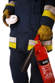 foto of smoke detector  - Firefighter holding an extinguisher and a smoke detector - JPG