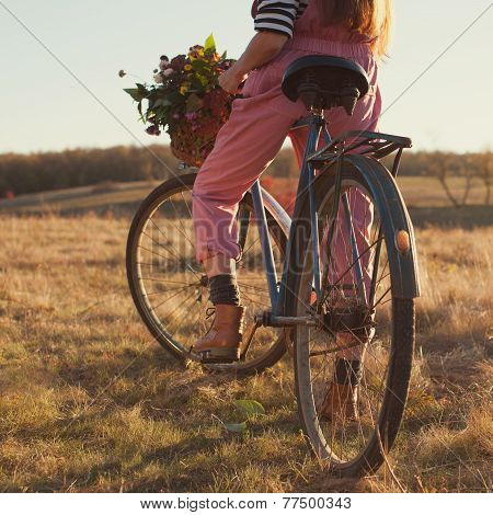 Oldfashioned Girl Ready To Ride A Retro Bike