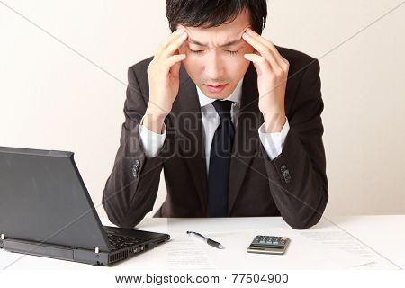 businessman suffers from headache
