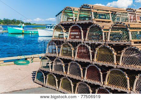Lobster traps piled at the wharf in rural Prince Edward Island, Canada.