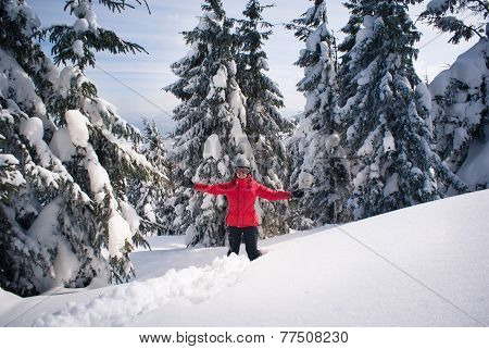 Cheerful Woman Among Fir Trees In The Snow