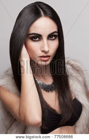 Closeup Of Fashionable Model In Fur Vest And Black Lingerie