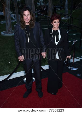 LOS ANGELES - SEP 13:  Ozzy Osbourne & Sharon Orbourne arrives to Brent Shapiro Foundation Summer Spectacular 2014  on September 13, 2014 in Los Angeles, CA