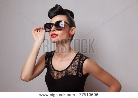 Young Fashionable Woman In Round Sunglasses Posing In Guipure Dress. Red Lips. Updo, Twisted High Bu