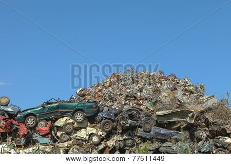 Scrap yard with cars and metal shreds