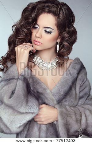 Beauty Fashion Model Woman In Mink Fur Coat. Winter Brunette Girl In Luxury Clothes. Long Wavy Hair.